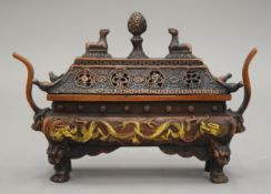 A small rectangular Chinese incense burner and cover on four feet. 19.5 cm wide.