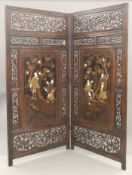 A Japanese Meiji period lacquered, mother-of-pearl, bone and ivory inset two fold screen. 181.