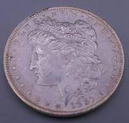 A silver Morgan dollar 1887.