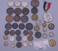 A quantity of coins and medals, including some silver.