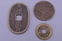Three vintage Chinese coins.
