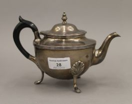 A silver teapot. 13 cm high. 12.9 troy ounces total weight.