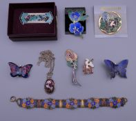 A quantity of enamel jewellery.