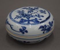 An 18th century Chinese blue and white porcelain circular box and cover painted with flowers.
