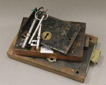 Three antique door locks with keys. The largest 25.5 cm long.