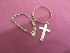 9ct hallmarked gold crucifix and gate bracelet, and another bracelet stamped 375, 6.5g (3)