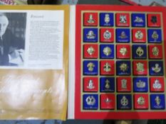 Commemorative folder of mounted Great British Regiments badges