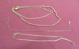 Two 9ct gold necklaces stamped 375, a necklace stamped 14K and a paperchain link necklace stamped