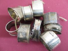 Collection of nine Victorian and later hallmarked silver napkin rings, variously decorated,