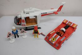 Sylvanian Families gypsy caravan, Playmobil helicopter, racing car, quantity of figures, motorbikes,