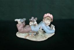 "Lladro figurine 5451 ""Study Buddies"" in original box, H10cm and Lladro figurine 7619 ""All Aboard"" in"