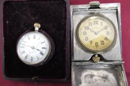 Geo V. eight day travelling clock in engine turned silver case, Birmingham 1926 and a Swiss 19th C