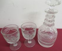 Georgian crystal decanter with triple ringed faceted neck and hobnail band H26cm and a pair of