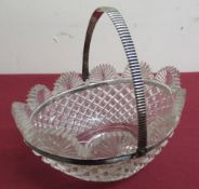 Early 20th C strawberry cut glass oval waived edge bonbon basket, continental white metal swing