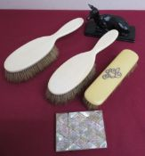 Victorian mother of pearl card case, pair of ivory hairbrushes, ivorine hairbrush, and a resin model