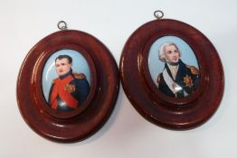 Pair of mahogany framed oval porcelain plaque portraits of Nelson and Napoleon Bonaparte (14cm x