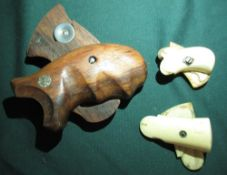 Two pairs of 19th C ivory pistol grips 5.5cm and 5cm, and a pair of wooden Smith & Wesson pistol