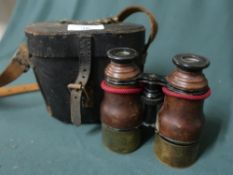 A pair of leather bound field glass in case