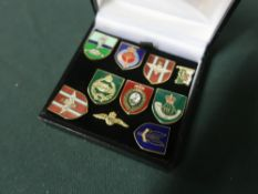 Collection of ten military lapel badges including RAF wings, SAS etc