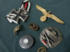 Collection of German metal badges including Iron Cross, tank corp badge, eagle cap badge, etc (7)