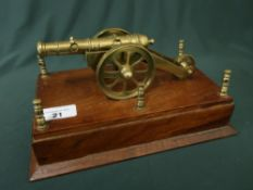 Well detailed miniature brass cannon model mounted on wooden plinth