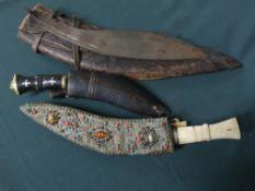 Bone handled kukri with ornate decoration to scabbard, small belt sized kukri, kukri blade and a