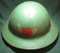 c.WWII British steel helmet with liner, webbing and chinstrap, with painted decal