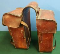 Pair of German c.WWI leather saddle bags, with various stamped numbers