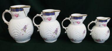 "Set of four Coalport reproduction ""Caughley Mask-Head"" graduated jugs (4)"