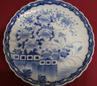 Japanese waved edge circular blue and white charger, all over decorated with chrysanthemums on a
