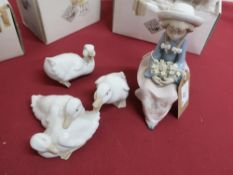 Lladro model of a girl seated with a posy of flowers, in Nao box, and three Nao figures No 368,