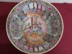 Large Japanese circular bowl, polychrome decorated in Famille enamels with panels of figures and