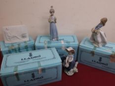 Three Lladro porcelain models of girls with flower baskets No 5.222, 5.467 and 5.604, in original