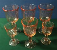 Suite of rose tinted glassware including stemmed wine glasses, sherry, liquors etc
