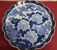 Japanese waved edge circular blue and white charger, all over decorated with chrysanthemums,