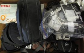 Various photographic equipment including a Pentax Espio 160, a Panasonic FZ8 camera, a Pentax