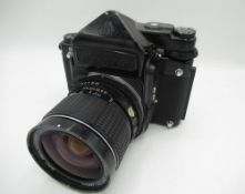 Pentax 67 medium format camera with a Pentax 55mm F4 lens and metered prism head (untested)
