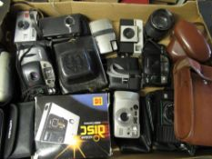 Collection of various cameras including: Canon AF7, Zenith, Pentax Espio 928m, Kodak easy share