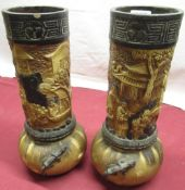 Pair of early C20th Bretby vases decorated with oriental garden scene and lizards, relief and