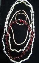Natural pearl necklace with 14ct gold clasp stamped 14K L145cm, a necklace with faceted ruby