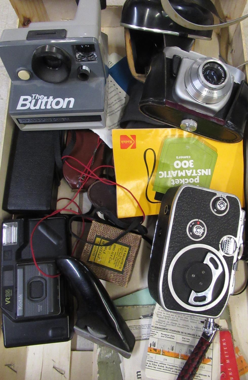 Polaroid button camera, Kodak VR35 camera, Beirette 35mm camera, Bolex cine camera and various
