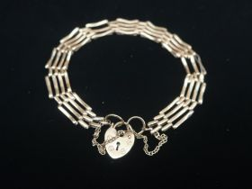 Hallmarked 9ct gold 4 bar gate bracelet with safety chain and heart padlock clasp stamped 375 6.