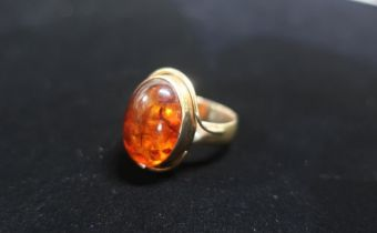 Hallmarked 9ct gold and Amber ring Size O gross 6.5g