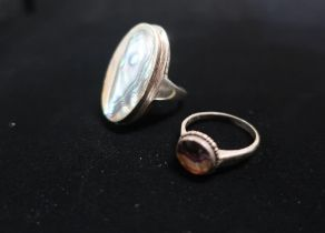 Aberlone Mother of Pearl ring with silver mount stamped 925 Size M and another ring with amethyst