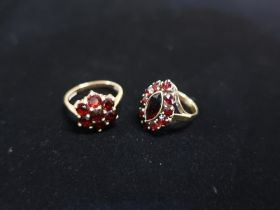 Hallmarked gold and garnet flower design ring Size P (marks unknown and another Garnet marquise