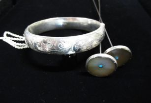 Pair of Edwardian silver hat pins inset with mother of pearl and central turquoise stone back
