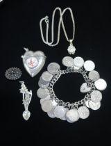 Heart shaped Sterling silver vesta with enamel cherub stamped 925 silver, a Sterling silver love