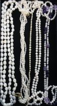 Collection of pearl necklaces including different styles and a simulated pearl necklace with
