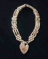 Hallmarked 9ct gold 3 bar gate bracelet with safety chain and heart padlock clasp stamped 375 20.4g