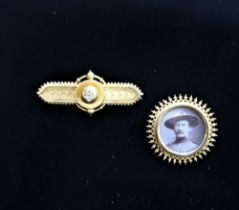 15ct gold and Diamond bar brooch stamped 15ct, 6.5g and another brooch with portrait